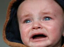 crying baby showing how to deal with stubborn kids