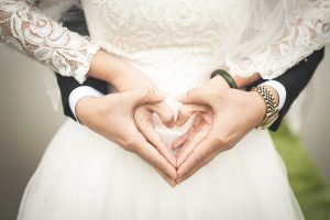 hands making a heart showing things to think about before marriage